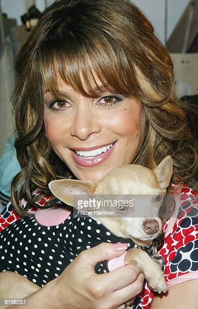 TV personality Paula Abdul with Yoda the dog poses backstage wearing Petro Zillia at the Mercedes Benz Fashion Week at Smashbox Studios on March 29...