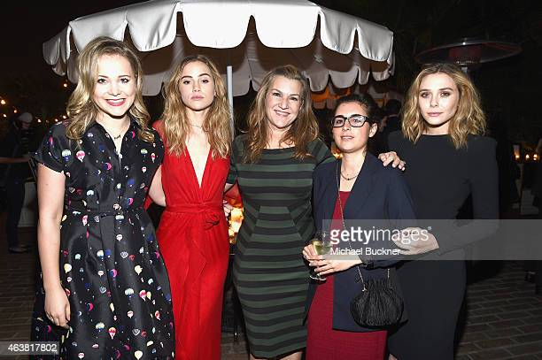 TV personality Poppy Jamie actress Suki Waterhouse executive west coast editor Krista Smith guest and actress Elizabeth Olsen attend VANITY FAIR and...
