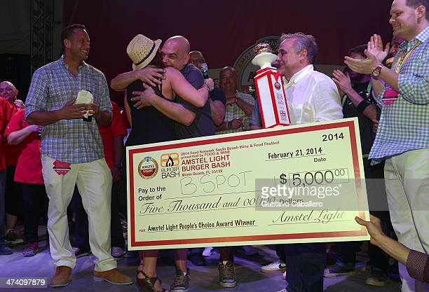 Personality Rachael Ray Chef Michael Symon and Founder Director of Food Network South Beach Wine Food Festival Lee Brian Schrager attend Amstel Light...