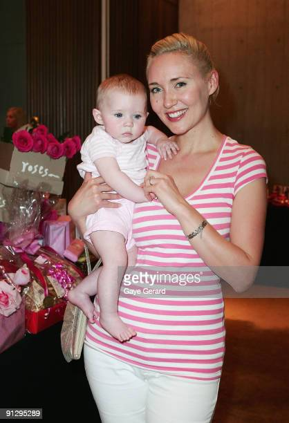 Personality Radio Host and Author Bessie Bardot with her baby Bluebell pose during the McGrath Foundation High Tea at the Ivy on October 1 2009 in...