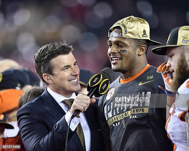 ESPN personality Rece Davis speaks to Clemson University quarterback Deshaun Watson during the award ceremony after the second half of the CFP...