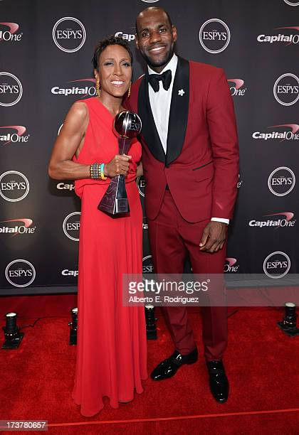 TV personality Robin Roberts recipient of the Arthur Ashe Courage Award and NBA player LeBron James pose backstage at The 2013 ESPY Awards at Nokia...
