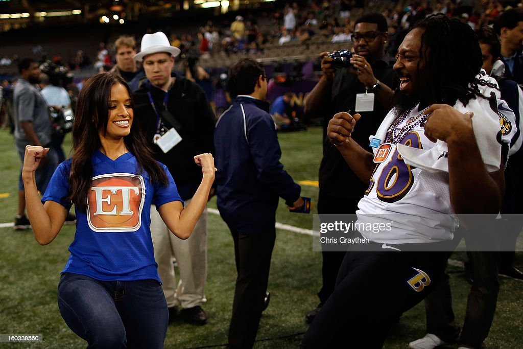 TV personality Rocsi Diaz of 'Entertainment Tonight' dances with Damien Berry #28 of the Baltimore Ravens during Super Bowl XLVII Media Day ahead of Super Bowl XLVII at the Mercedes-Benz Superdome on January 29, 2013 in New Orleans, Louisiana. The San Francisco 49ers will take on the Baltimore Ravens on February 3, 2013 at the Mercedes-Benz Superdome.