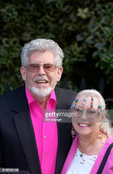 TV personality Rolf Harris and his wife Alwen attend a celebrity party hosted by broadcaster Sir David Frost in Chelsea