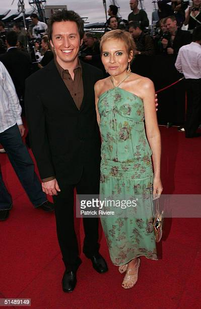 TV personality Rove McManus and girlfriend actress Belinda Emmett arrive for the 2004 ARIA Awards at the Superdome October 17 2004 in Sydney Australia