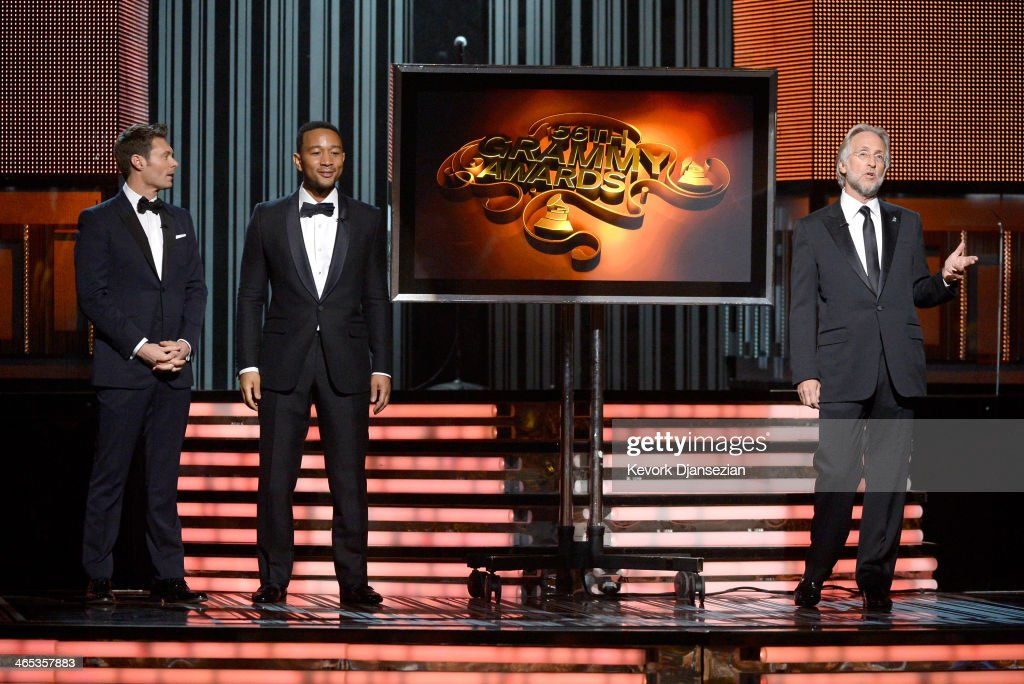 TV personality Ryan Seacrest, musician John Legend, and Recording Academy President Neil Portnow speak onstage during the 56th GRAMMY Awards at Staples Center on January 26, 2014 in Los Angeles, California.