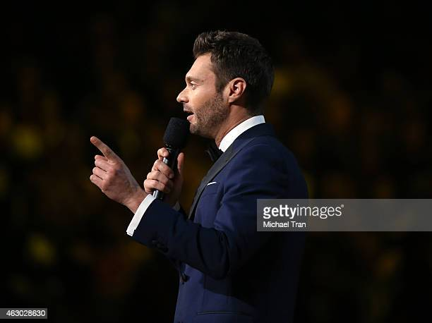 TV personality Ryan Seacrest speaks onstage during The 57th Annual GRAMMY Awards at STAPLES Center on February 8 2015 in Los Angeles California