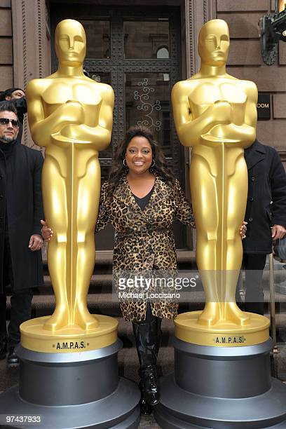 TV personality Sherri Shepherd poses between the two 8foot golden Oscar statues delivered for the official Academy of Motion Picture Arts and...