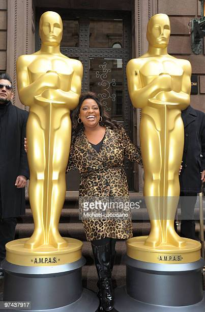 TV personality Sherri Shepherd poses between the two eightfoot golden Oscar statues delivered for the official Academy of Motion Picture Arts and...
