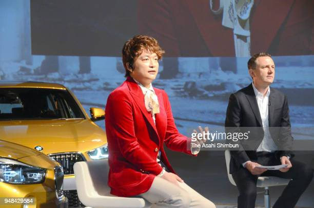 TV personality Shingo Katori and BMW Japan President Peter Kronschnabl attend the BMW's new sport utility vehicle 'X2' unveiling on April 16 2000 in...