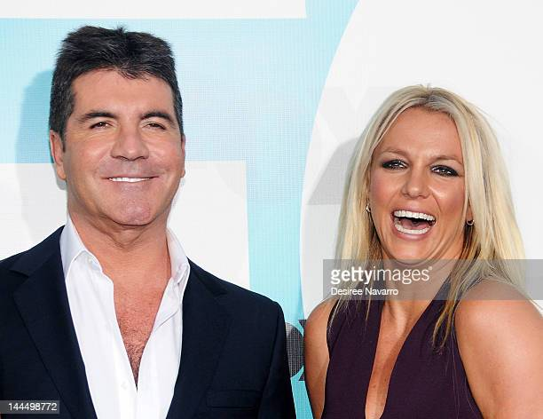 Personality Simon Cowell and singer Britney Spears attend the Fox 2012 Programming Presentation PostShow Party at Wollman Rink Central Park on May 14...