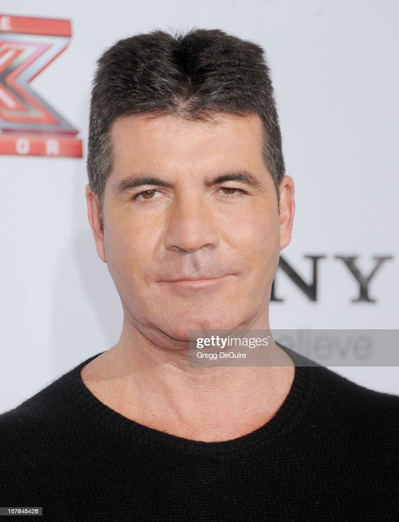 TV personality Simon Cowell arrives at FOX's 'The X Factor' viewing party at Mixology101 & Planet Dailies on December 6, 2012 in Los Angeles, California.