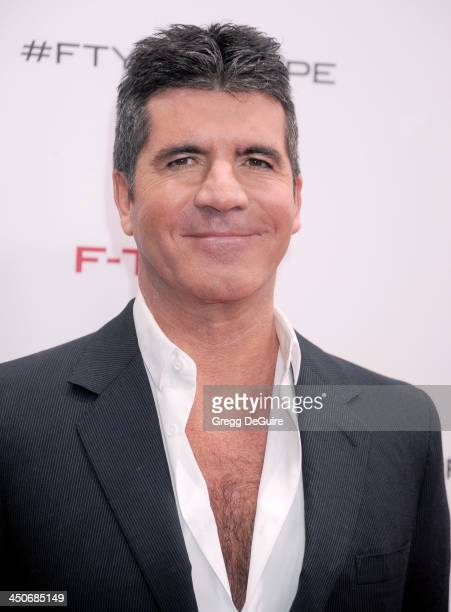 TV personality Simon Cowell arrives at the Jaguar FTYPE Coupe launch party at Raleigh Studios on November 19 2013 in Playa Vista California