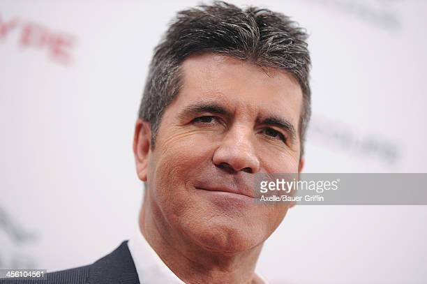 Personality Simon Cowell attends the launch party for the Jaguar F-TYPE Coupe at Raleigh Studios on November 19, 2013 in Playa Vista, California.