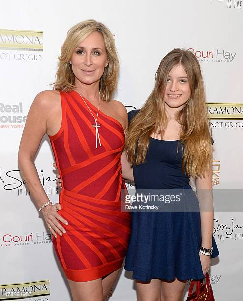 TV personality Sonja Morgan and guest attends the 'The Real Housewives Of New York City' season six premiere party at Tokya on March 12 2014 in New...