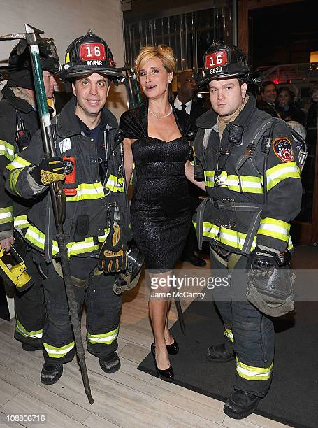 Personality Sonja Morgan with New York City Firefighters attends an exclusive shopping event benefiting Jeffrey Fashion Cares hosted by Details and...