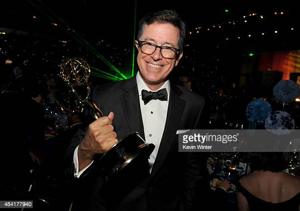 TV personality Stephen Colbert poses with his Outstanding Variety Series award during the 66th Annual Primetime Emmy Awards Governors Ball held at...