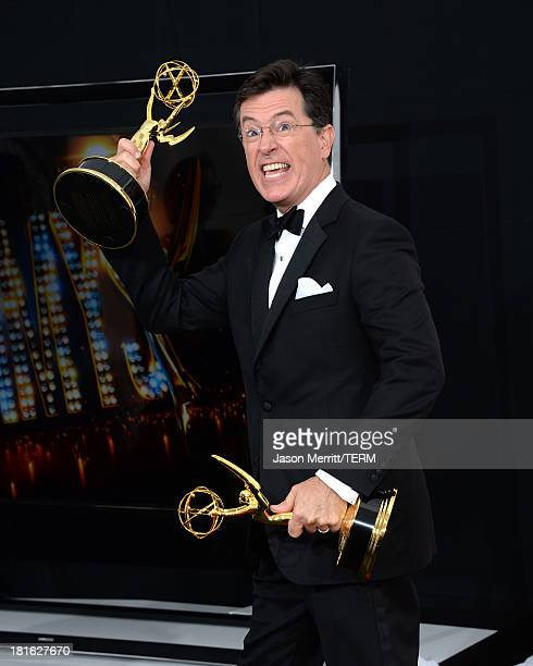 TV personality Stephen Colbert winner of the Best Writing for a Variety Series Award and the Variety Series Award for The Colbert Report poses in the...
