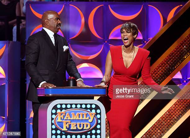 TV personality Steve Harvey and host Tyra Banks speak onstage during The 42nd Annual Daytime Emmy Awards at Warner Bros Studios on April 26 2015 in...