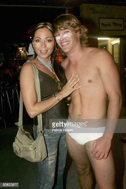 Personality Tania Zaetta poses with model Angus Street at the Cleo Centrefold sizzling VIP and Celebrity BBQ at the North Bondi Surf Life Saving Club...