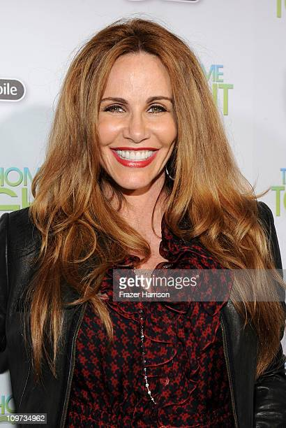 Personality Tawny Kitaen arrives at Relativity Media presents the premiere of Take Me Home Tonight held at Regal Cinemas LA Live Stadium 14 on March...