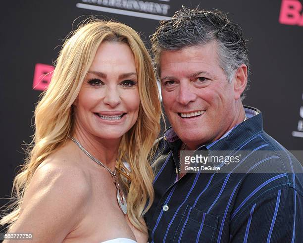 TV personality Taylor Armstrong and husband John Bluher arrive at the premiere of STX Entertainment's Bad Moms at Mann Village Theatre on July 26...