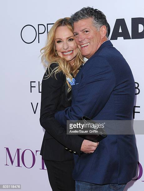 TV personality Taylor Armstrong and John Bluher arrive at the Open Roads World Premiere Of 'Mother's Day' at TCL Chinese Theatre IMAX on April 13...