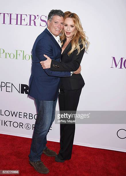 TV personality Taylor Armstrong and John H Bluher attend the Open Roads World Premiere of 'Mother's Day' at the TCL Chinese Theatre IMAX on April 13...