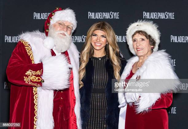 TV personality Teresa Giudice poses with Santa Claus and Mrs Claus during 'Sleigh' A Toys for Tots Event and Meet Greet at Valanni on December 7 2017...