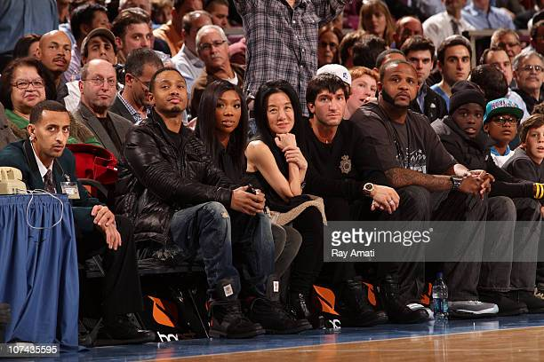 Personality Terrence J and RB Singer Brandy attend the Toronto Raptors game against the New York Knicks on December 8 2010 at Madison Square Garden...