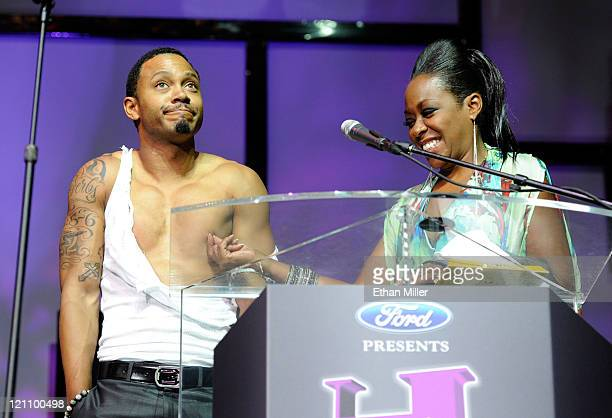 Personality Terrence Jenkins and actress Tichina Arnold onstage during the ninth annual Ford Hoodie Awards at the Mandalay Bay Events Center August...