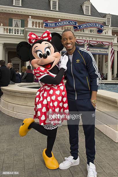 Personality Terrence Jenkins poses with Minnie Mouse during the Disney Dreamers Academy weekend at Walt Disney World Resort on March 07 2015 in Lake...