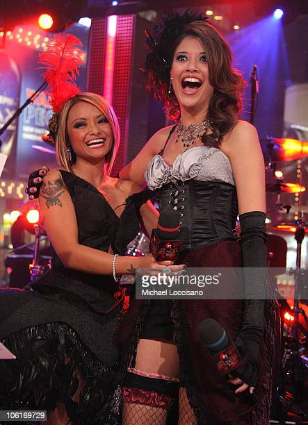 TV personality Tila Tequila and MTV VJ Lyndsey Rodrigues on stage during Tila Tequila's MTV New Year's Eve Masquerade party at MTV Times Squre...