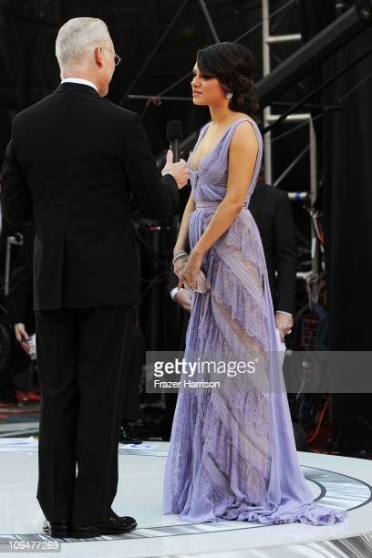 TV personality Tim Gunn interviews actress Mila Kunis at the 83rd Annual Academy Awards held at the Kodak Theatre on February 27 2011 in Hollywood...