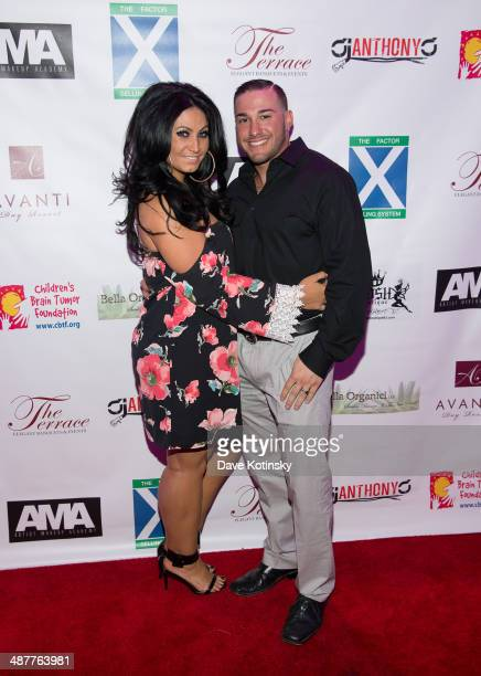 TV personality Tracy DiMarco and husband Corey Epstein attend the Posh Boutique fashion show at The Terrace on May 1 2014 in Paramus New Jersey