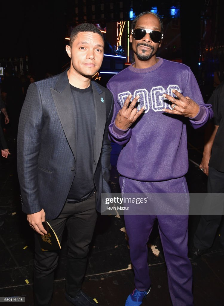 TV personality Trevor Noah (L) and recording artist Snoop Dogg attend the 2017 MTV Movie And TV Awards at The Shrine Auditorium on May 7, 2017 in Los Angeles, California.