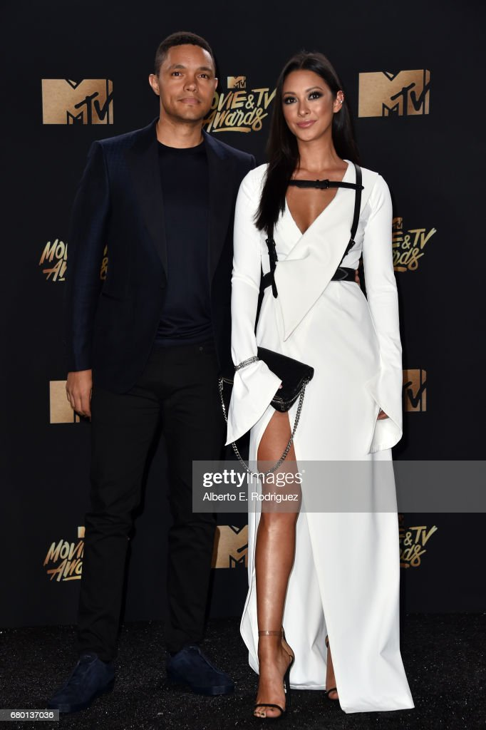 TV personality Trevor Noah and singer Jordyn Taylor attend the 2017 MTV Movie And TV Awards at The Shrine Auditorium on May 7, 2017 in Los Angeles, California.