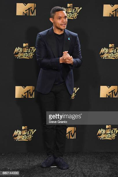 TV personality Trevor Noah poses in the press room at the 2017 MTV Movie and TV Awards at The Shrine Auditorium on May 7 2017 in Los Angeles...