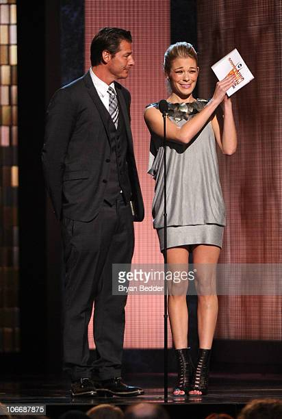 TV personality Ty Pennington and musician LeAnn Rimes speak onstage at the 44th Annual CMA Awards at the Bridgestone Arena on November 10 2010 in...