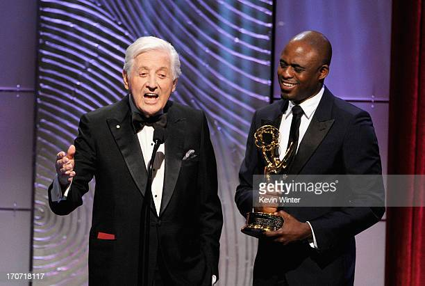 TV personality Wayne Brady presents Monty Hall with The Lifetime Achievement Award onstage during The 40th Annual Daytime Emmy Awards at The Beverly...