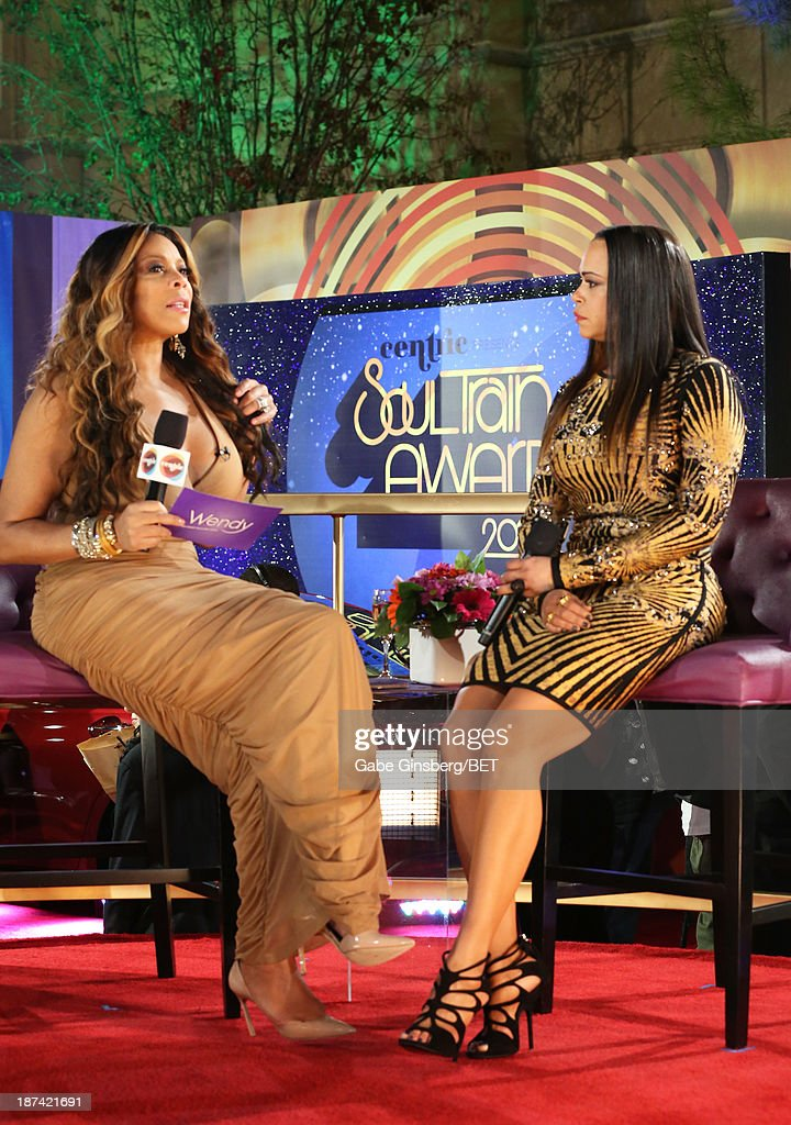 TV personality Wendy Williams and singer Faith Evans attend the Soul Train Awards 2013 at the Orleans Arena on November 8, 2013 in Las Vegas, Nevada.