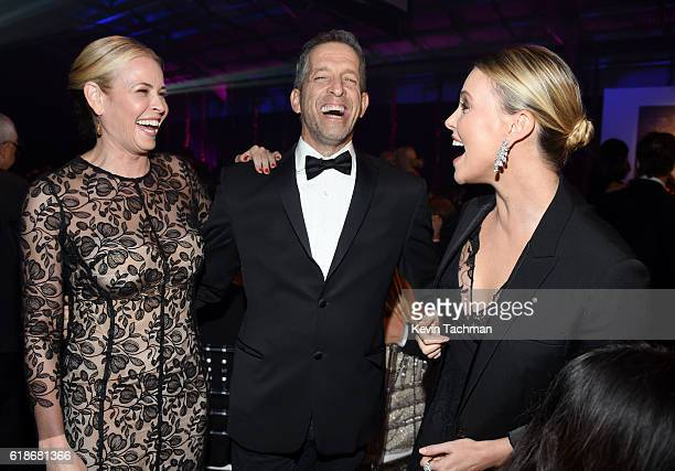 TV personality/comedian Chelsea Handler designer Kenneth Cole and actress Charlize Theron attend amfAR's Inspiration Gala at Milk Studios on October...