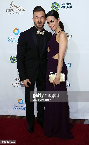TV personality/dancer Artem Chigvintsev and actress Torrey DeVitto attend the Steve Irwin Gala Dinner at JW Marriott Los Angeles at LA LIVE on May 21...