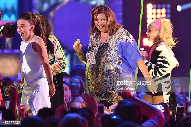 TV personality/dancers Kendall Vertes Abby Lee Miller and and Jojo Siwa walk onstage to accept the Favorite Reality Award for 'Dance Moms' onstage...