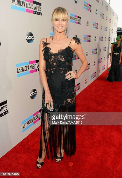 Personality/Model Heidi Klum attends the 2013 American Music Awards at Nokia Theatre LA Live on November 24 2013 in Los Angeles California