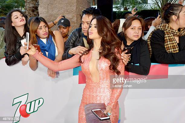 TV personality/model Jessica Cediel takes a selfie with a fan during the 16th Latin GRAMMY Awards at the MGM Grand Garden Arena on November 19 2015...