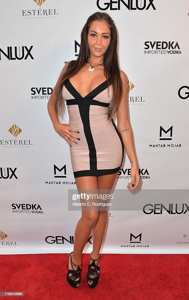 TV personality/model Nabilla Benattia arrives to Genlux Magazine's Issue Release party featuring Erika Christensen at The Sofitel Hotel on August 29, 2013 in Los Angeles, California.