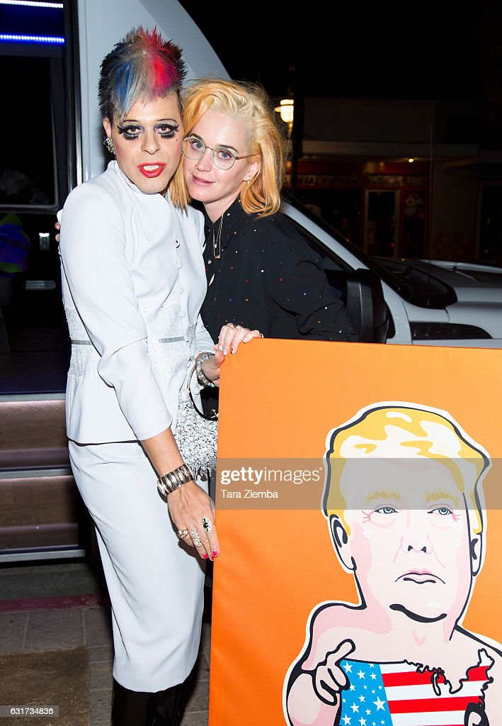 TV Personality/pop artist Sham Ibrahim and singer Katy Perry pose for a photo with a Donald Trump portrait at Oscar's on January 14, 2017 in Palm Springs, California.