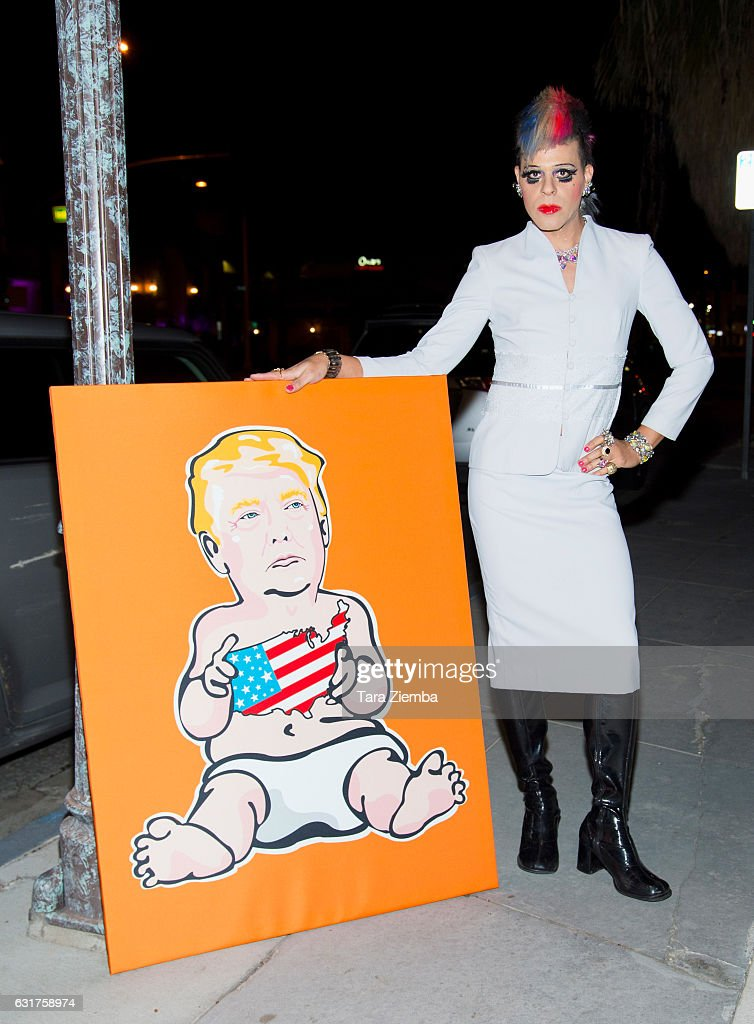 TV Personality/Pop artist Sham Ibrahim poses for a photo with his portrait of Donald Trump at Oscar's on January 14, 2017 in Palm Springs, California.