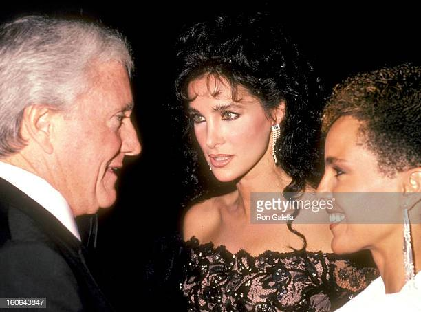 Personality/Producer Merv Griffin Actress Connie Sellecca and Actress Shari Belafonte attend the 1984 Carousel of Hope Ball on October 13 1984 at...